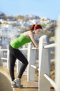Taking in the moment young healthy athletic woman a break and enjoying view while jogging Royalty Free Stock Image