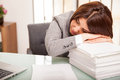 Taking a nap at work pretty young business woman after too much the office Royalty Free Stock Photo