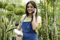 Taking an order from a customer cute female gardener on the phone Stock Photography