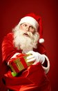 Taking out gifts portrait of happy santa claus present of big red sack Royalty Free Stock Photos
