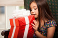 Taking a peek at a present cute little girl peeking inside of gift box Royalty Free Stock Photography