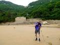 Taking photos on Thousand step sand beach Royalty Free Stock Photo
