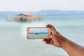 Taking photo of seascape with smartphone Royalty Free Stock Images