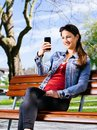 Taking photos with her smartphone photo of a beautiful young woman using a to take Stock Images