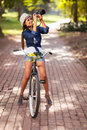 Taking pictures outdoors attractive young woman on her bike Royalty Free Stock Photography