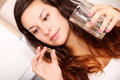 Taking a pill young woman with glass of water Stock Photography