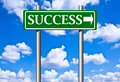 Taking the road to success in green boards and blue sky Stock Photo