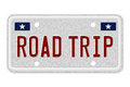 Taking a road trip in the united states the words on gray license plate isolated on white with the us colors and stars Royalty Free Stock Image