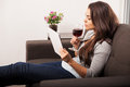 Taking a sip of wine Royalty Free Stock Photo