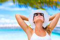 Taking sunbath on the beach portrait of young attractive female with hands behind head summer vacation maldives Stock Photos