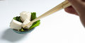 Taking tofu with chopstick a piece of Royalty Free Stock Photography