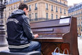 A talented homeless musician plays the piano in the street to earn some money paris mar on march paris france Royalty Free Stock Photography