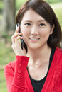 Talk on cellphone attractive young woman take a call closeup portrait Stock Photos