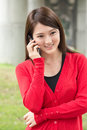 Talk on cellphone attractive young woman take a call closeup portrait Royalty Free Stock Photography