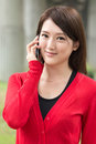 Talk on cellphone attractive young woman take a call closeup portrait Royalty Free Stock Images