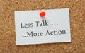 Less talk more action the phrase on a cork notice board as the motivation to getting things done at work or at home Royalty Free Stock Photo