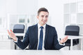 Talkative young businessman is very during his job interview Stock Photography