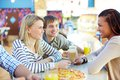Talking in bar image of teenage friends interacting cafe Royalty Free Stock Photo