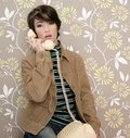 Talking telephone retro woman on vintage wallpaper Royalty Free Stock Photo