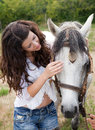 Talking to her horse Royalty Free Stock Photography