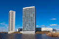 Tall apartment towers at the water front with blue sky modern apaprtment flats in netherlands Stock Images