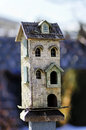 Tall bird house sitting birdhouse outdoor old handmade nice blurry background Stock Images