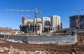 Tall buildings under construction with cranes against a blue sky Royalty Free Stock Images