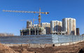 Tall buildings under construction with cranes against a blue sky Stock Photo