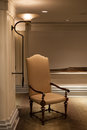 Tall chair adjacent to the south wall lamp in the hotel Royalty Free Stock Photo