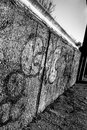Abstract view of a section of the supposed Berlin Wall showing graffiti on the wall itself.