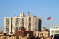 Tall generic building a apartment with an american flag seen from yankees stadium in new york city Stock Images