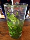 A tall glass of mojito with whole mint leaves and this is cold minty all its ice fresh Royalty Free Stock Image