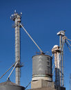 Tall grain silo s feed pumps Stock Images