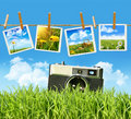 Tall grass with old vintage camera and pictures Royalty Free Stock Photos