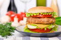 Tall hamburger on a plate Royalty Free Stock Photo