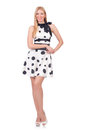 Tall model dressed in dress with polka dosts on white Royalty Free Stock Images