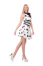 Tall model dressed in dress with polka dosts on white Stock Photography
