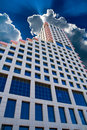 Tall office building and clouds on the sky Stock Photos