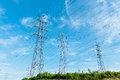 Tall power lines electricity transmission tower under the blue sky Stock Photos