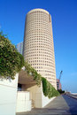 Tall round building near river in Tampa Florida Royalty Free Stock Photo