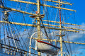 Tall sailing ship closeup detail of mast sails crows nest and canvas can be seen in this an old time wooden Stock Image