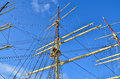 Tall sailing ship closeup detail of mast sails crows nest and canvas can be seen in this an old time wooden Royalty Free Stock Photos