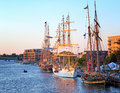 Tall ship celebration in bay city michigan usa july ships at berth on the saginaw river with s downtown the background the ships Stock Photos