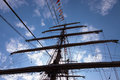 Tall ship mast of with rolled up sails Stock Photos