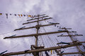 Tall ship masts mast with signal flags and rolled up sails Royalty Free Stock Images