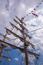 Tall ship masts mast with signal flags and rolled up sails Stock Image