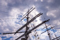Tall ship masts mast with signal flags and rolled up sails Stock Photo