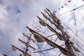 Tall ship masts mast with signal flags and rolled up sails Royalty Free Stock Photos