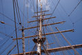 Tall ship masts mast with signal flags and rolled up sails Royalty Free Stock Photo