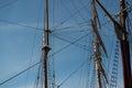 Tall ship masts towards a blue sky Royalty Free Stock Photography